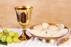 Chalice of wine and a Ciboria with the Communion
